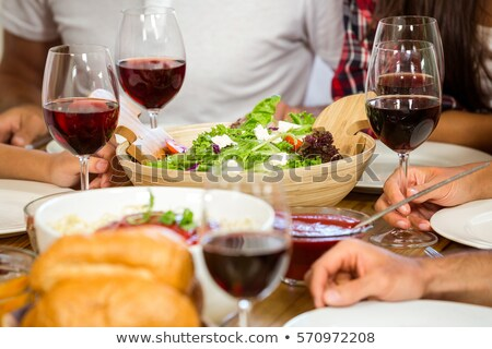 Mid section of woman having red wine at table Stock photo © wavebreak_media
