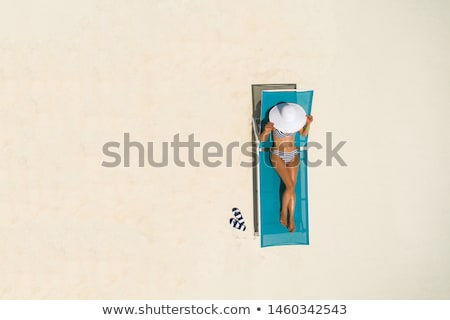 woman lying in a sun lounger Stock photo © IS2