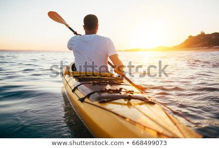 Geel kajak meer selectieve aandacht water sport Stockfoto © stevanovicigor