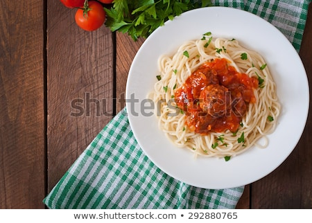 Meatballs in sauce with vegetables, top view Stock photo © yelenayemchuk