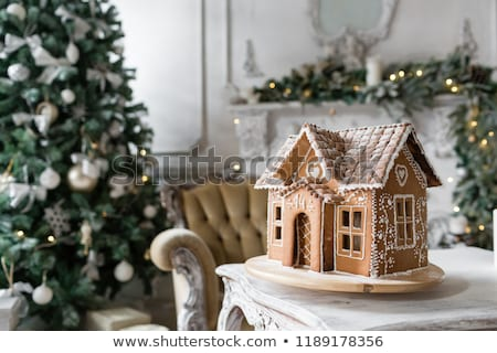 Christmas gingerbread house with sugar icing Stock photo © orensila
