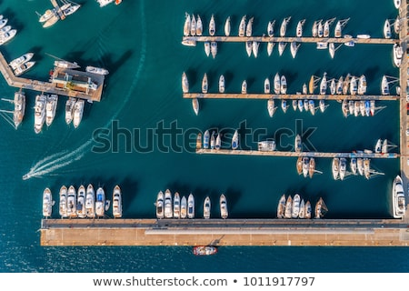 aerial view of amazing boats at sunset minimalistic landscape stock photo © denbelitsky