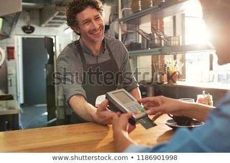 Olgun kadın kredi kartı kadın finanse kanepe Stok fotoğraf © IS2