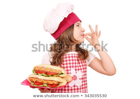 happy little girl cook with hot dog and ok hand sign Stock photo © goce