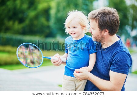 Little boy playing badminton with his dad Stock photo © deandrobot