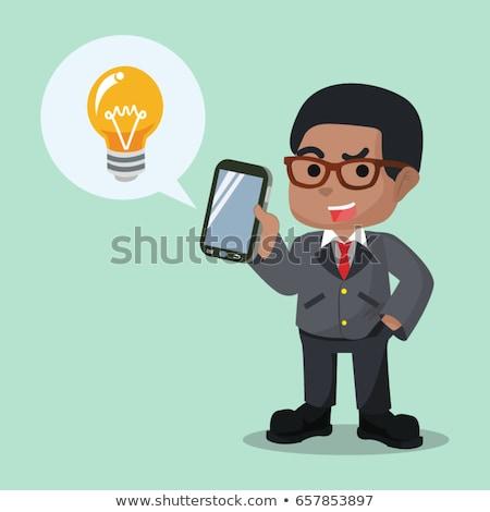 african businessman holding idea light bulb stock photo © studioworkstock