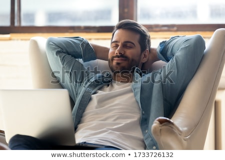 Homme rêvasser main visage souriant Homme Photo stock © IS2