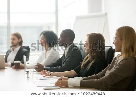 üzletember konferenciaterem készít jegyzetek férfi notebook Stock fotó © IS2