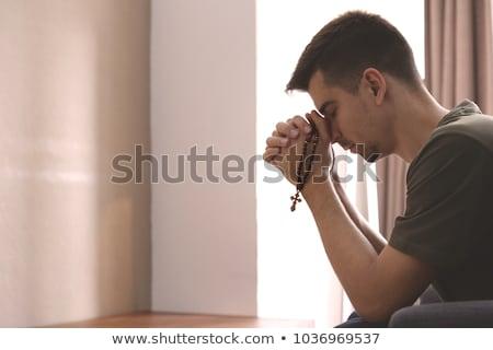 Uomo pregando rosario mano culto maschio Foto d'archivio © IS2