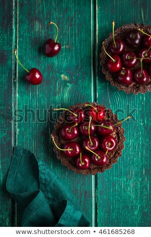 Tasty Cake with Dark Chocolate and Cherries on Top Stock photo © robuart