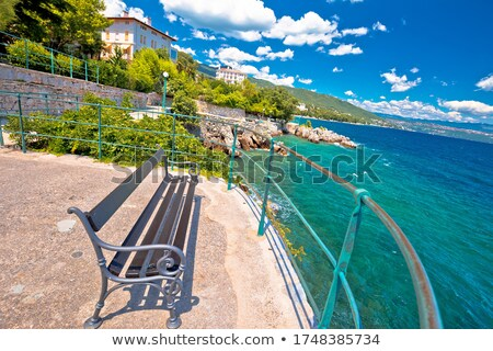 Bench by the sea on Lungomare walkway in Opatija riviera Stock photo © xbrchx