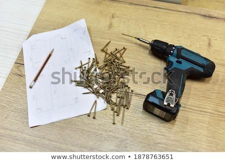 screws in wooden boxes at workshop Stock photo © dolgachov