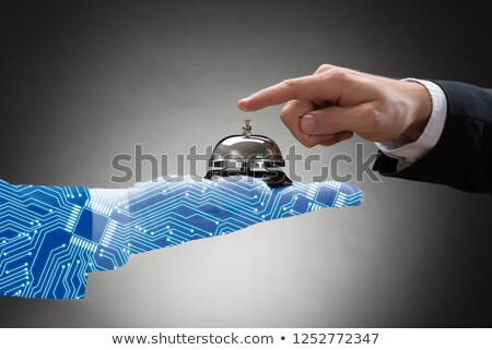 Ringing Service Bell Held By Digital Generated Human Hand Stock photo © AndreyPopov