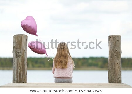Cheerful, littlel girl realxing on a jetty Stock photo © konradbak