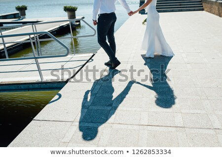 a pair of lovers walk on the pier near the yachts Stock photo © ruslanshramko