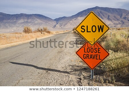 Slow Loose Gravel Sign Along Rural Road Stock photo © pancaketom