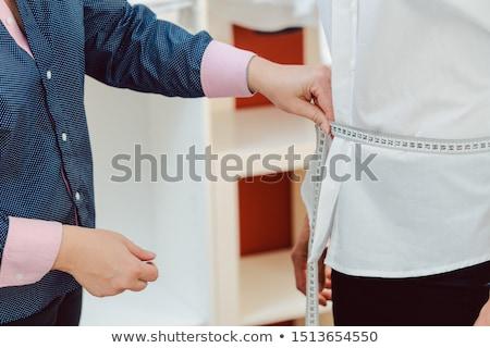 портной женщину рубашку шее Сток-фото © Kzenon