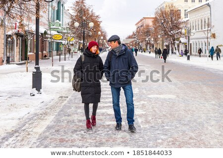 Wintertime Couples of People Walking Along Street Stock photo © robuart