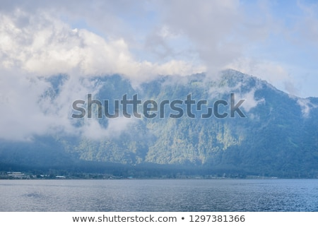 Amazing views of Lake Bratan and the mountains covered with clouds Stock photo © galitskaya