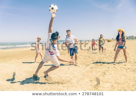 grupo · feliz · amigos · jugando · pelota · de · playa · verano - foto stock © dolgachov