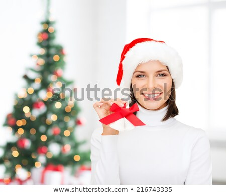 happy woman in santa hat with jingle bells at home Stock photo © dolgachov