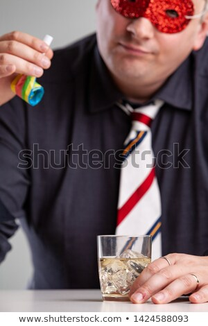 Man sitting drinking at party looking at a blower Stock photo © Giulio_Fornasar