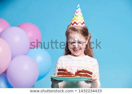Cute funny girl laughing while holding plate with birthday cake Stock photo © pressmaster