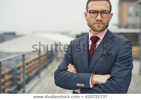 resolute businessman standing with folded arms stock photo © giulio_fornasar