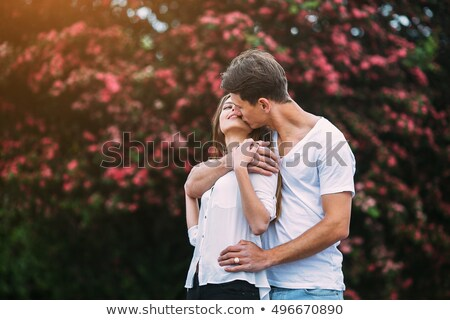 young couple embraces in a summer garden Stock photo © Lopolo