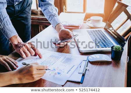 close up of hands two business people discussing new project in stock photo © freedomz