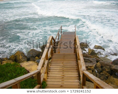 wooden pier with stair in sea water Stock photo © dolgachov