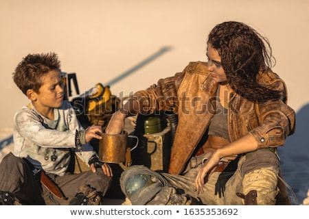 Post apocalyptic Woman and Boy Outdoors in a Wasteland Stock photo © artfotodima