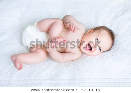 sweet little baby boy lying on knitted blanket Stock photo © dolgachov