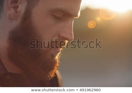 Young man with eyes closed for meditation or thinking Stock photo © cienpies