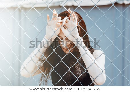 Sad fence girl Stock photo © Lopolo