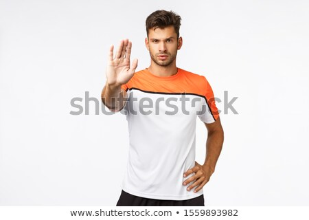 No tresspassing. Serious-looking determined young handsome male athlete in sportswear, t-shirt, pull Stock photo © benzoix