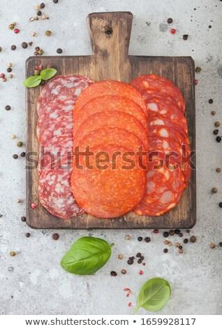 чоризо колбаса Ломтики пепперони салями базилик Сток-фото © DenisMArt