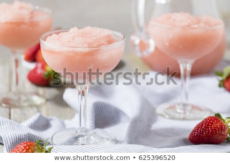glass of rose wine and strawberry stock photo © inaquim
