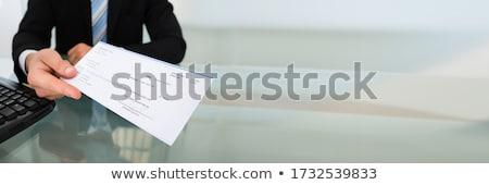 Csekk kölcsön nők tart nő papír Stock fotó © AndreyPopov
