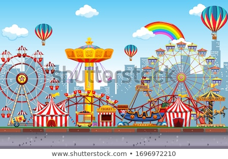 Themepark scene with many rides and balloons Stock photo © bluering