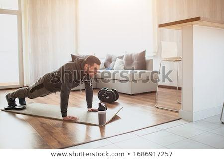 Young Men Doing Exercise For Abs Stock photo © Jasminko
