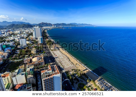 Aerial view over Nha Trang city, Vietnam taken from rooftop, extreme wide angle Stock photo © galitskaya
