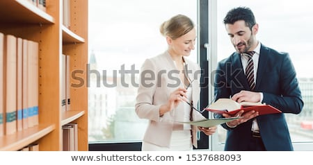Turkish and central European lawyer in their law firm working Stock photo © Kzenon