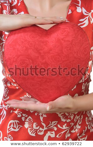 Woman holds a red heart opposite the bust stock photo © alrisha
