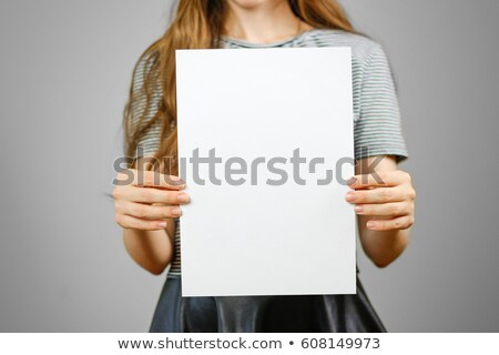 young woman keeps white sheet of paper stock photo © paha_l