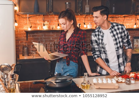 Young couple looking at a recipe book stock photo © photography33
