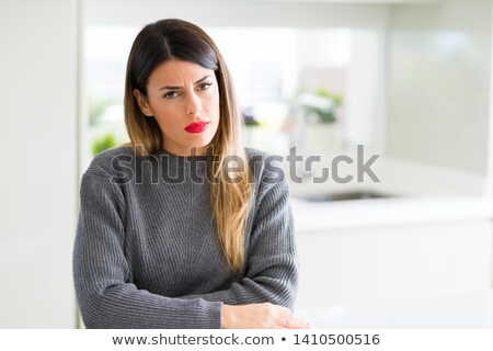 Portrait of a an incredulous woman Stock photo © photography33
