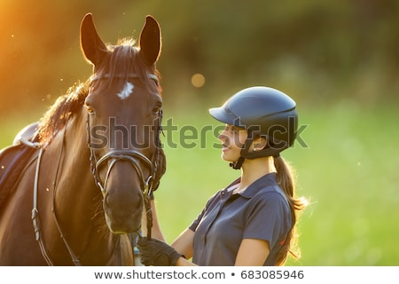 A horseback rider with her horse Stock photo © photography33
