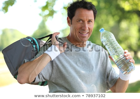 50 years old man drinking man after he did sport Stock photo © photography33