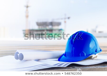 Construction worker verifying a building drawing Stock photo © photography33